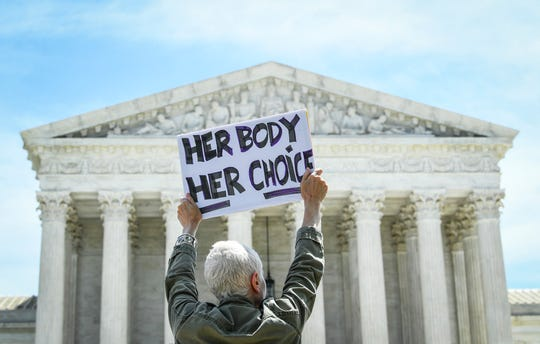 Protesters rally against abortion bans in the United States on the steps of the U.S. Supreme Court in Washington on May 21, 2019.
