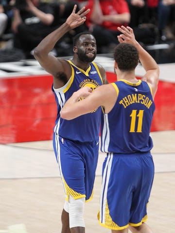 f7691375f262 Golden State Warriors forward Draymond Green celebrates with guard Klay  Thompson after making a 3-