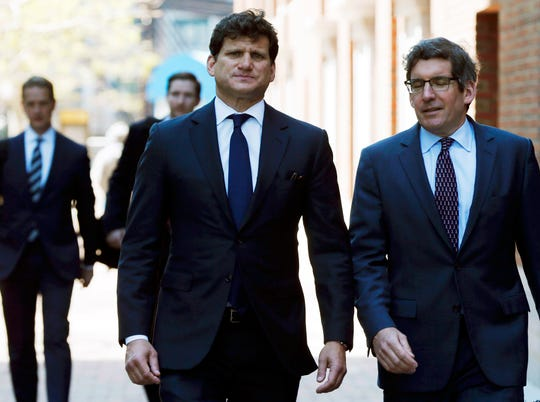 Gordon Caplan, center, arrives at federal court Tuesday, May 21, 2019, in Boston, where he pleaded guilty to charges in a nationwide college admissions bribery scandal. (AP Photo/Michael Dwyer)