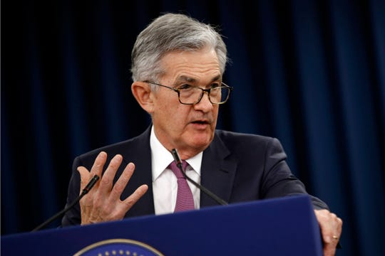 FILE - In this Wednesday, May 1, 2019, file photo, Federal Reserve Board Chair Jerome Powell speaks at a news conference following a two-day meeting of the Federal Open Market Committee, in Washington. Powell says a sharp rise in corporate debt is being closely monitored but currently the Fed does not see the types of threats that triggered the 2008 financial crisis.