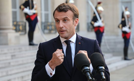 French President Emmanuel Macron gestures as he speaks during a press point with Portugal's Prime Minister prior to a state dinner, at the Elysee Palace, in Paris on May 20, 2019.