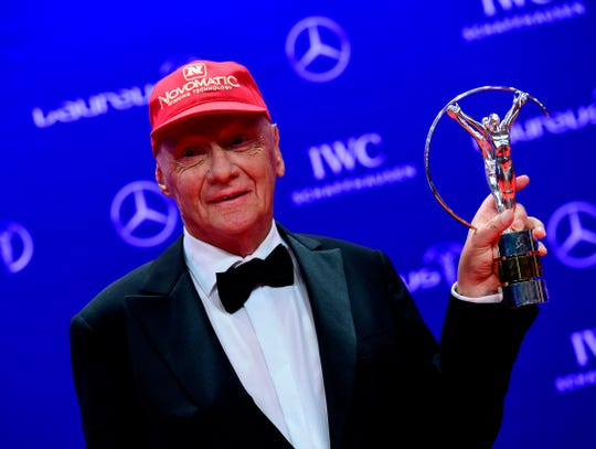 Niki Lauda poses with his Lifetime Achievement trophy from the 2016 Laureus World Sports Awards.