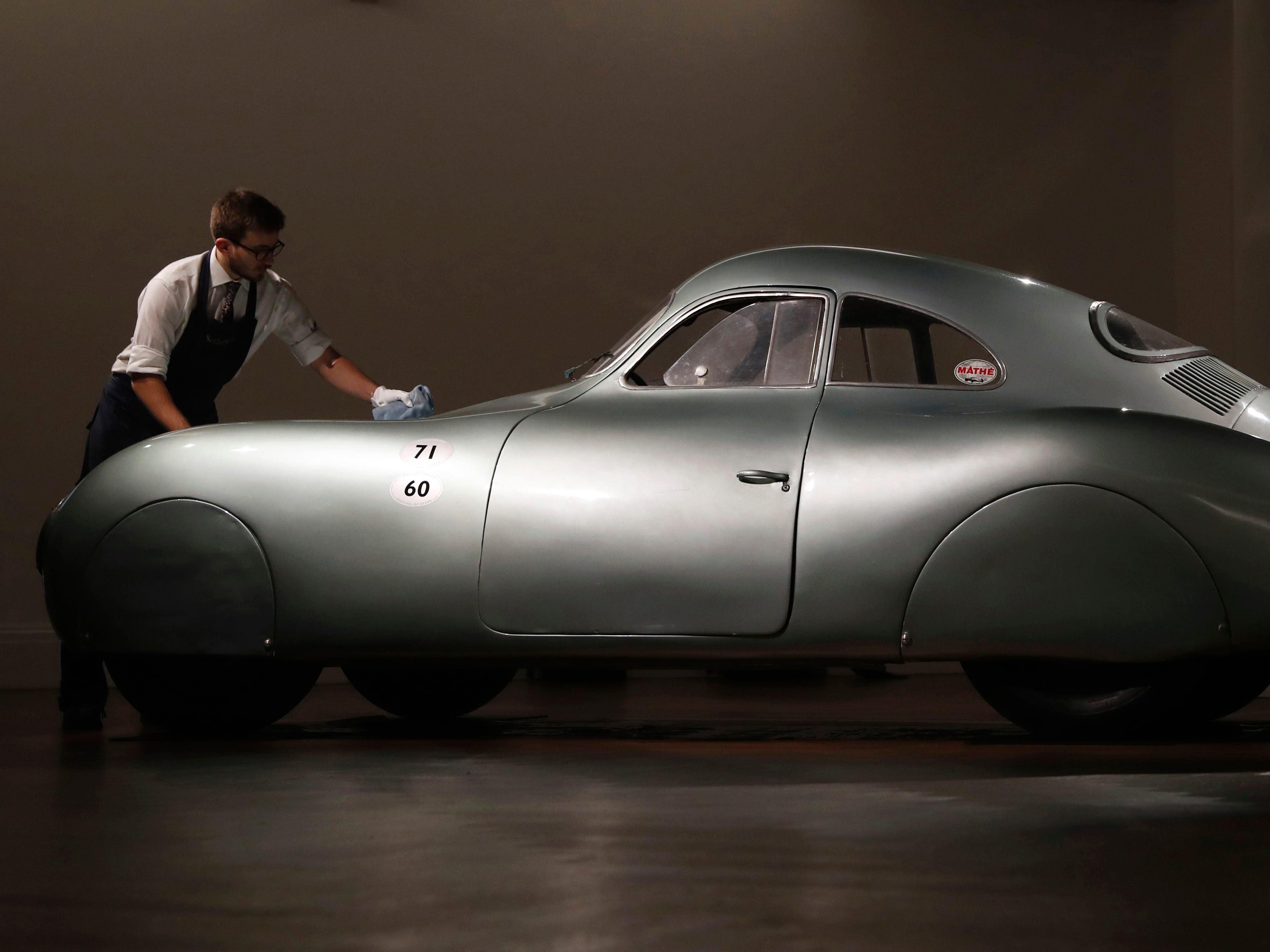 A 1939 Porsche Type 64, the oldest car to wear a Porsche badge and the personal car of German car designer and manufacturer Ferdinand and Ferry Porsche on display during a press preview at Sotheby's auction house in London, May 21, 2019. This is the only surviving example of the Type 64 Porsche which is a direct ancestor of the iconic Porsche 365. The car will go on sale at an auction in Monterey Ca. in August and is expected to sell at around $20 million.
