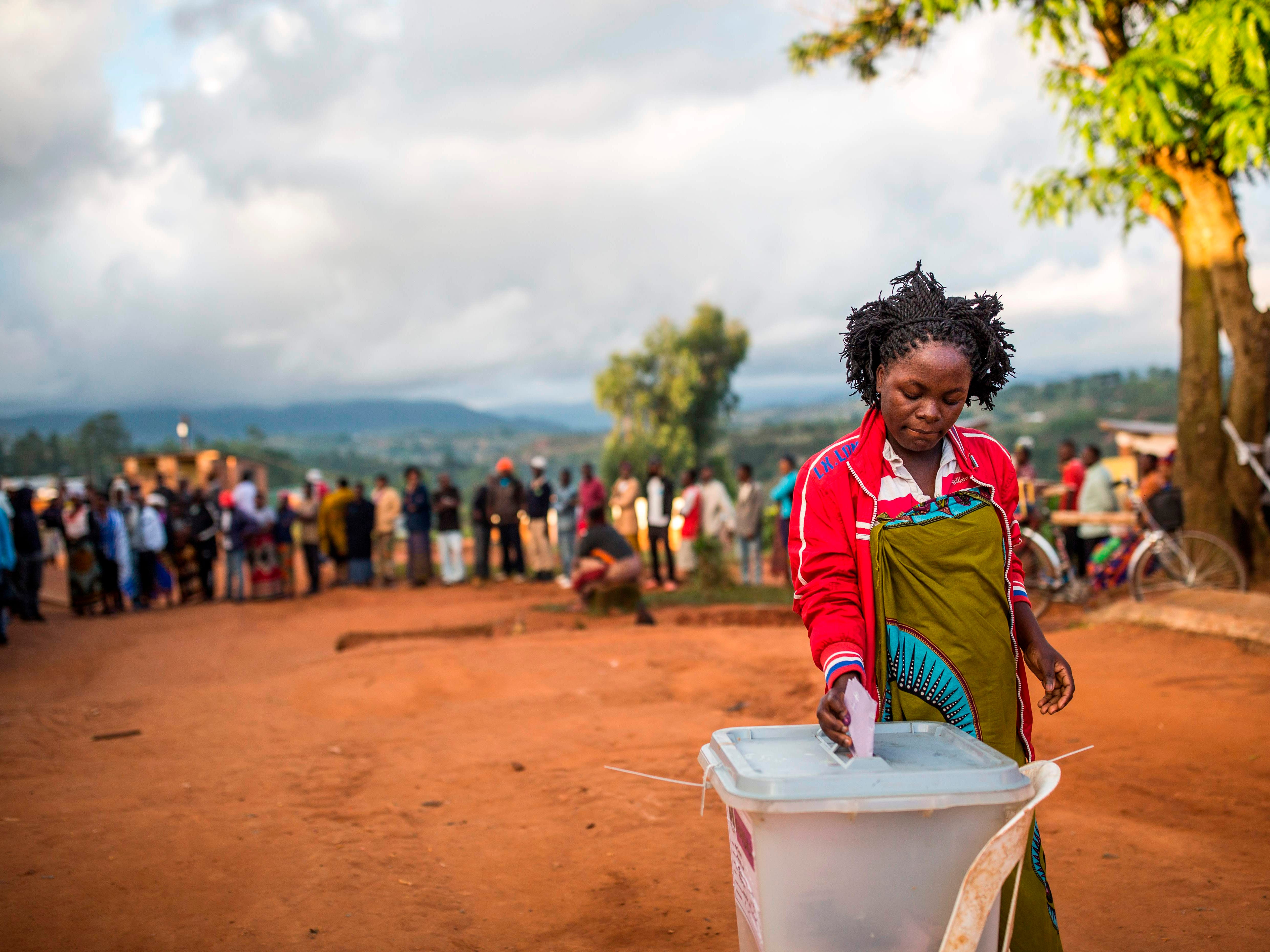 A woman casts her vote during general elections in Mzuzu, Malawi on May 21, 2019.  Malawi polls opened on May 21 after a closely-fought election campaign, with President Peter Mutharika battling to hold off two serious rivals in a race that has focused on corruption allegations and economic development.