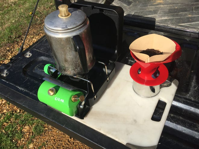 The Optimus Hiker+ camp stove is a small, no-nonsense, self-contained liquid-fuel stove.