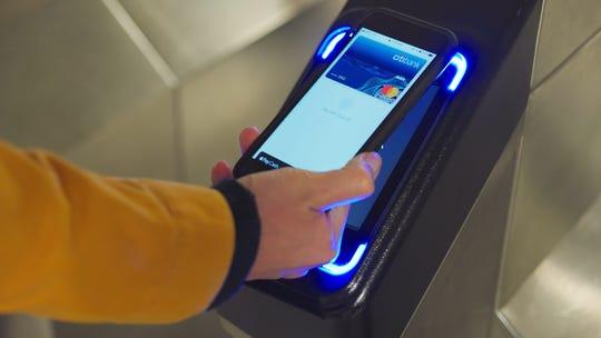 Mastercard demonstrates paying at a subway terminal.