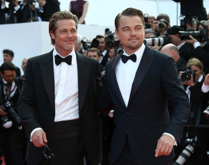 Leonardo DiCaprio kept it professional on the red carpet, posting with co-star Brad Pitt.