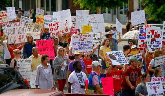 Protesters march to the Alabama Capitol to protest a bill to ban abortion that passed last week , Sunday, May 19, 2019, in Montgomery, Ala.