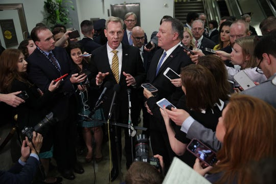 Acting U.S. Defense Secretary Patrick Shanahan (L) speaks to members of the media as Secretary of State Mike Pompeo (R) listens after a closed briefing for Senate members May 21, 2019 on Capitol Hill in Washington, DC. Acting Secretary Shanahan and Secretary Pompeo joined Chairman of Joint Chiefs of Staff Joseph Dunford to brief Congressional members on Iran.