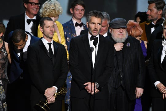 "George R.R. Martin, right, says that compared to ""Game of Thrones"" producers D.B. Weiss and David Benioff, he will have time to craft endings for beloved characters."