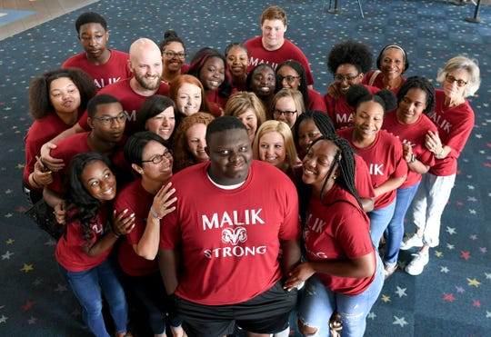 "Malik Stowers, a sophomore from Westside High School, joins AVID classmates, some of over 150 wearing ""Malik Strong"" t-shirts on a class field trip to see 80s movie ""Sandlot"" at AmStar Cinemas in Anderson Wednesday, May 22. Stowers, who plays offensive line for the football team as well, found out May 1 he has Acinic Cell Carcinoma, a rare form of cancer and needs treatment. On his GoFundMe page, it says ""Stowers is a model son, student, brother, and athlete. He is committed to working hard and being his best all around. He strives to be a role model to his sister, support/help  to his mother, Nemesha Stowers,  who is raising them on her own, and is so loved by his peers and teachers."""