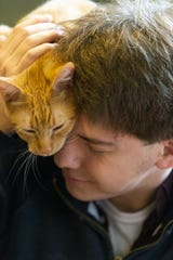 Kevin Graves of San Diego snuggles with Topanga.