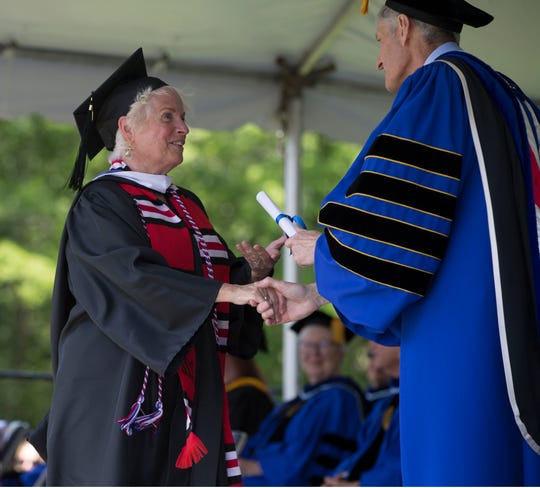 Barbara Kulusic receives her diploma. Georgian Court University celebrates its 108th annual commencement ceremony on campus grounds. 