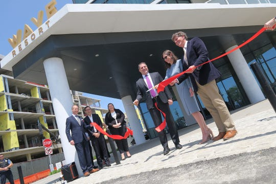 Kusher Companies Principal Nicole Kushner-Meyer is joined by Long Branch Mayor John Pallone (right) and the company's Head of Hospitality Operations Robert Dunic in cutting the ribbon marking the opening of the Wave Resort on the Long Branch boardwalk Wednesday, May 22, 2019.