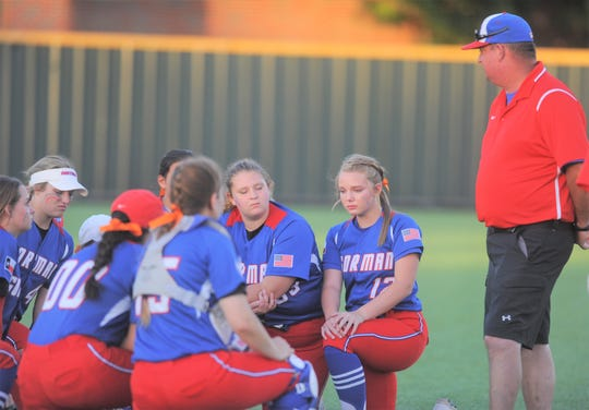 Gorman softball coach Nick Guthery addresses his team following the softball Region II-1A final against Dodd City on May 21, 2019, at Kennedale High School.