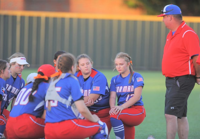 Gorman softball coach Nick Guthery addresses his team following the softball Region II-1A final against Dodd City on Tuesday at Kennedale High School.