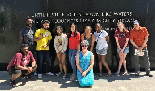 An Abilene group poses for a keepsake photo in front of the Civil Rights Memorial in Montgomery, Alabama. Standing. from left, are Marcus McCray, Philip Lerma, Subhanna Taveras, Yuwei Bao, Sylvia Harmon, Bria Kimble, Kaitlyn Thompson and Robert Wallace. Kneeling are Jaquay Thomas and Sarah Kirkland.