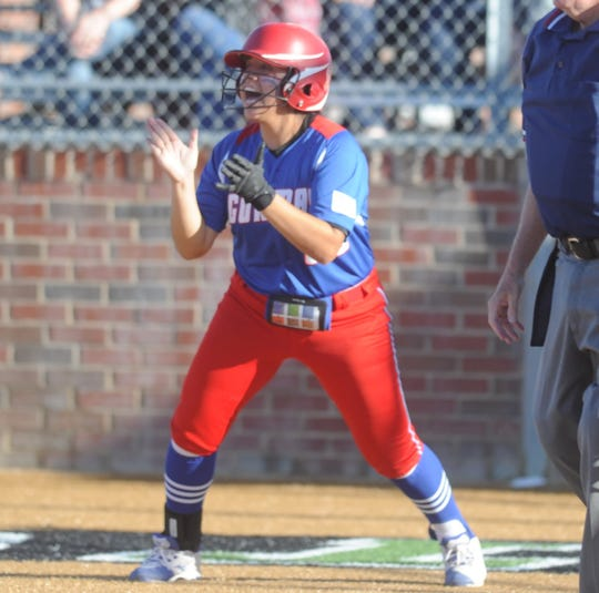 Gorman's Briana Landa celebrates behind the plate after scoring in the first inning of the softball Region II-1A final against Dodd City on May 21, 2019, at Kennedale High School.