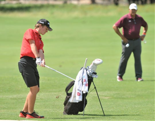 Cooper freshman Karson Grigsby hits onto the green at No. 7  at the Class 5A state golf tournament Tuesday, May 21, 2019, at White Wing Golf Club in Georgetown. Grigsby shot even-par 72 to finish the tournament with a 151.