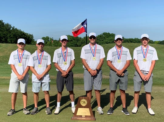 The Goldthwaite boys golf team stands with its Class 2A state championship trophy at Roy Kizer Golf Course in Austin.