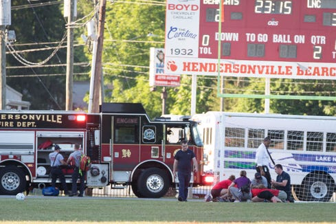 Hendersonville's senior goalkeeper Camryn Coggins is treated after a serious injury during a May 21 state semifinal game.