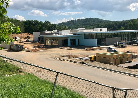 BMW of Asheville will move into this new location off Long Shoals Road this summer. Long-range plans call for another dealership brand owned by Fields Automotive, possibly the local Mercedes dealership, to also locate on the property.