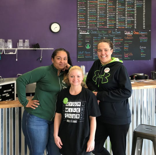 Angela Collins, Janelle Swank and owner Heidi Fields serve up Herbalife products and fitness at The Nutrition PENN, a new business inside Capital Square in Pennfield.