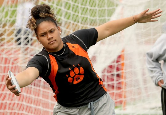 Central Kitsap's Ho'oponokauilani Fuiava warms up with the discus during practice on Tuesday, May 21, 2019.
