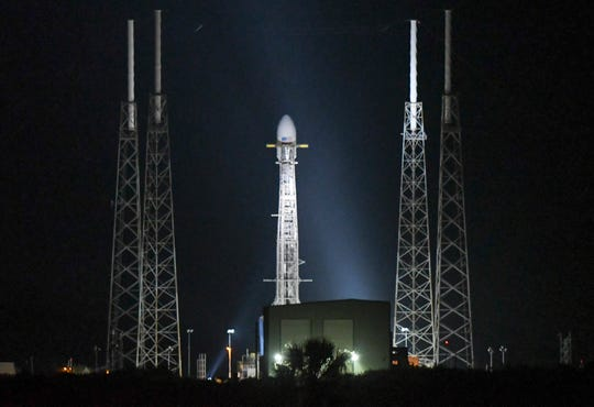 A SpaceX Falcon 9 rocket sits on the pad at Cape Canaveral Air Force Station Wednesday, May, 15, 2019. Launch of the rocket, carrying 60 Starlink internet communications satellites, was scrubbed due to upper-level winds.