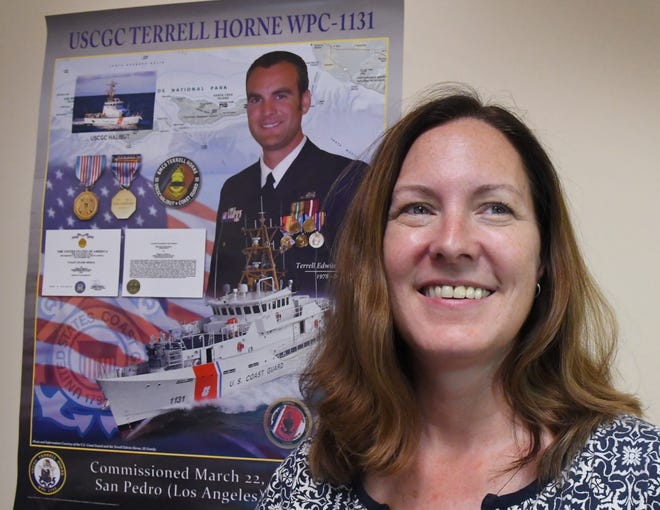 Brandie Kemper of Canaveral Groves stands in front of a poster honoring her brother, Coast Guard Senior Chief Petty Officer Terrell Horne III, who recently had a Coast Guard cutter named after him. Horne died of injuries he suffered while trying to apprehend drug smugglers. His story will be featured in a television documentary airing at 9 a.m. Sunday on the USA Network.  e.  who once resided in Brevard County, lost his life in 2012 during counter-smuggling operations off the coast of Southern California. The man who