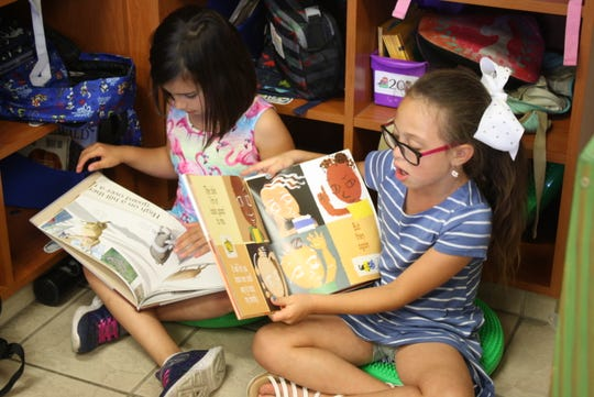 First-graders at Quest Elementary find a corner to read together.