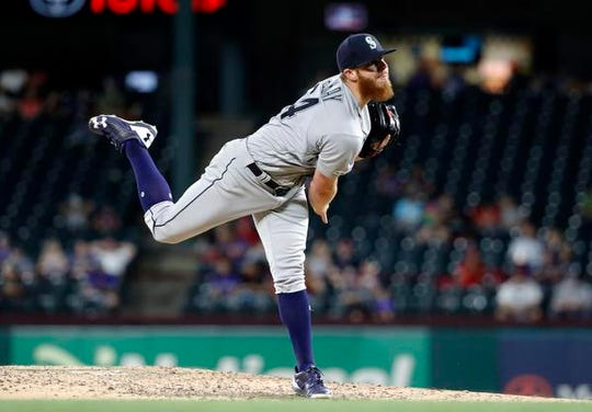 Seattle Mariners relief pitcher David McKay follows through on his delivery to the Texas Rangers in his Major League debut in the eighth inning of a baseball game against the Texas Rangers in Arlington, Texas, Monday, May 20, 2019.  McKay, a former Viera High pitcher, played in the 10-9 Rangers win, giving up one hit and not allowing a run in his one inning of work.