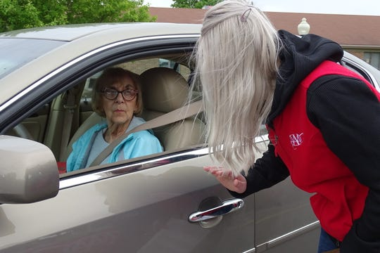 Candace Kalb of AAA Auto Club, right, helps Nancy Cook, 81, of Bucyrus, make sure her car's seat, mirrors and control are optimally positioned for safe driving during a CarFit event Tuesday at Heartland of Bucyrus,