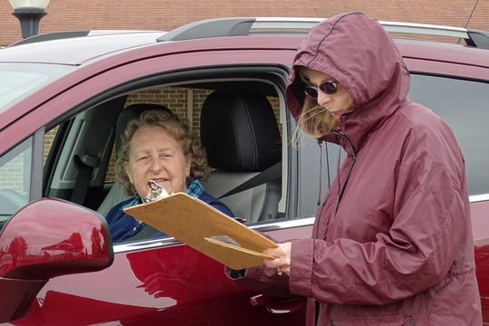 Occupational therapist Laura Roach, right, helps Ellen Johnson make sure her car's seat, mirrors and control are optimally positioned for safe driving during a CarFit event Tuesday at Heartland of Bucyrus,