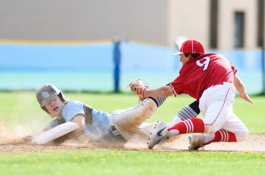 CVU's Baker Angstman (9) tags out South Burlington's Seamus McGrath (9) at second during the baseball game between the Champlain Valley Union Redhawks and the South Burlington Wolves at South Burlington High School on Tuesday afternoon May 21, 2019 in South Burlington, Vermont.