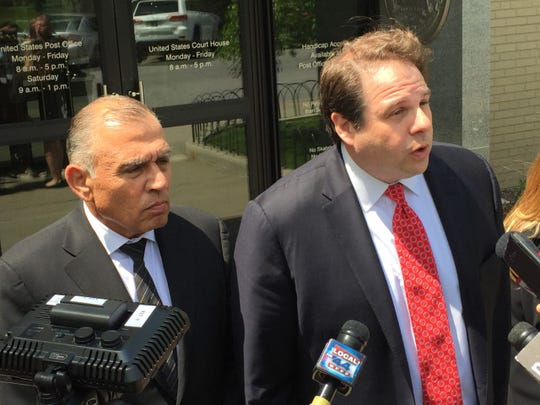 Ariel Quiros of Key Biscayne, Florida, left, seen leaving Vermont Federal Court in Burlington on Wednesday, May 22, 2019, to answer to charges related to a visa-fraud charge in Vermont's Northeast Kingdom. His lawyer, right, is Seth Levine.