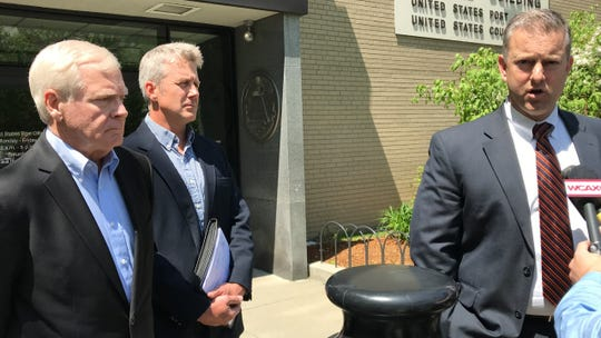 Bill Stenger of Newport, Vermont, left, seen leaving federal court in Burlington on Wednesday, May 22, 2019, after pleading not guilty to charges related to a visa-fraud case in Vermont's Northeast Kingdom. Lawyer Brooks McArthur, right, speaks to the media.