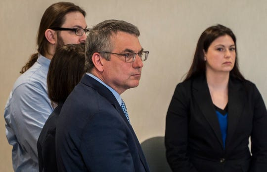 Steven Bourgoin's defense attorney Bob Katims listens as a jury pronounced Bourgoin guilty of five counts of second-degree murder in Vermont Superior Court in Burlington on Wednesday, May 22, 2019.