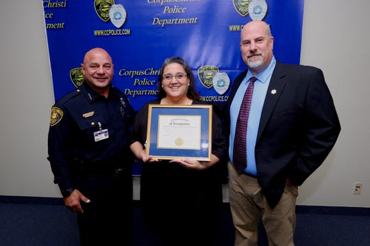 Corpus Christi Police Chief Mike Markle and OffenderWatch representative Scott Freeman present Yolanda Balli with a national certificate of recognition for outstanding public service of sex offender registry management Tuesday, May 21, 2019, at the Corpus Christi Police Department headquarters.
