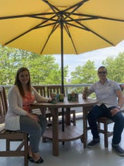 Sara Frias, director of sales and marketing for Adventure Aquarium, and Kirk LaVecchia, director of sales for Flying Fish Brewing Company, relax with Flying Fish beer in the new beer garden on the Camden Waterfront.