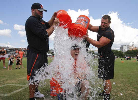 On Aug. 11, 2016, five months after he was diagnosed with amyotrophic lateral sclerosis, Paul Rinderknecht of Springfield Township recruited former Cincinnati Bengals Andrew Whitworth (77), left, Rex Burkhead (33) and Kevin Zeitler (68) to take the Ice Bucket Challenge at the conclusion of a practice session.