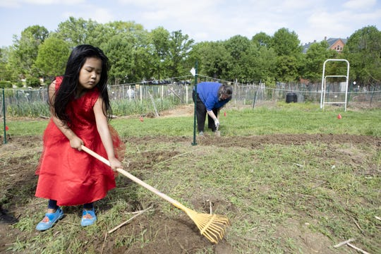 Pratisma Tamang, 4, is part of a family that grows food on several of the plots at the St. Clare Convent.