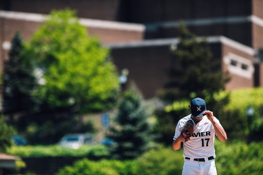 Xavier's Nick Zwack adjusts his hat during a game this season. Xavier co-hosts the Big East Conference Baseball Tournament this weekend May 23-26, 2019, at Prasco Park in Mason, Ohio.