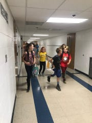 Students run to the bus on the last day of school May 22, 2019.