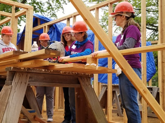 Women Builders hard at work sawing beams for door frames at Raritan Valley Habitat for Humanity's Women Build event.