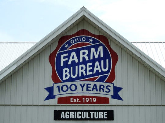 Completed centennial Ohio Farm Bureau logo on the Agriculture Building of the Coshocton County Fairgrounds.