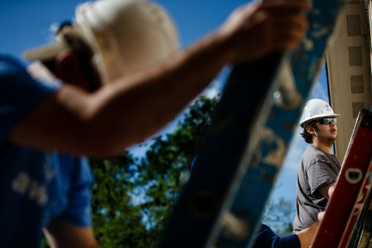 Volunteer Rey Munoz of Des Moines helps put siding on a home with Habitat for Humanity that is part of a community of 23 homes near Birdland Marina on Wednesday, May 22, 2019, in Des Moines. The city of Des Moines is updating its zoning code for the first time in more than 50 years, but some of the changes will make it difficult to build affordable housing in Des Moines.