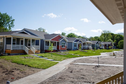 Finished homes sit on the left as part of a community of 23 homes built by Habitat for Humanity near Birdland Marina on Wednesday, May 22, 2019, in Des Moines. The city of Des Moines is updating its zoning code for the first time in more than 50 years, but some of the changes will make it difficult to build affordable housing in Des Moines.
