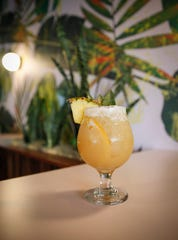 The Painkiller, one of the signature drinks at Bellhop, a new tiki bar in Des Moines East Village, which opens on Thursday, May 23.