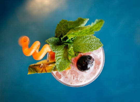 The Singapore Sling, one of the signature drinks at Bellhop, a new tiki bar in Des Moines East Village, which opens on Thursday, May 23.